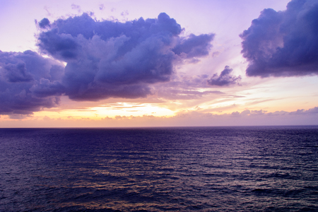 Picturesque view of beautiful cloudy sky at sunset on calm sea.