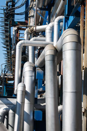 Steel pipes at the plant for processing and production of chemical products Stock Photo