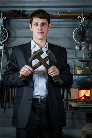 young handsome businessman in a strict suit is working in his forge