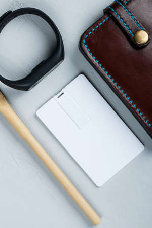 Business card blank, notepad, mobile phone, vallet, smart watch, notebook, mini food basket and pen at office desk table top view. Corporate stationery branding mock-up