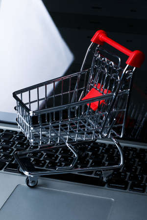toy grocery cart on black dark background. living basket Stock Photo