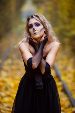 Dead horror warlock woman, scary female witch possessed by evil spirits. Book cover idea, day, park, autumn