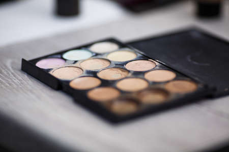 Make-up cosmetics in the beauty salon. shadows. Makeup palette for make up artist