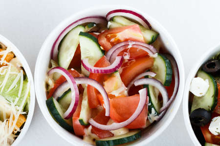 fresh vitamine salad onion, cucumber and tomates. top view. cafe menu, restaurant menu. close up Stock Photo