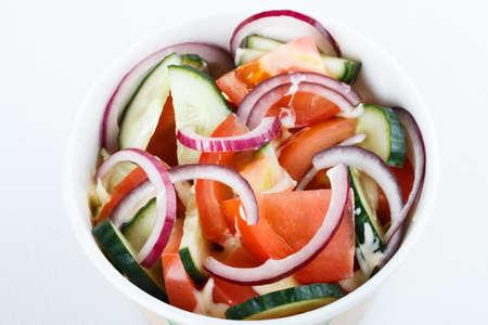 fresh vitamine salad onion, cucumber and tomates. top view. cafe menu, restaurant menu. close up Banco de Imagens
