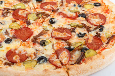 Pizza with Mushrooms, Broccoli, Cherry Tomatoes, Red Pepper, Black Olives and Mozzarella. Italian Pizza. Italian cuisine. Home made food. Concept for a tasty and hearty meal. Close up. Stock Photo