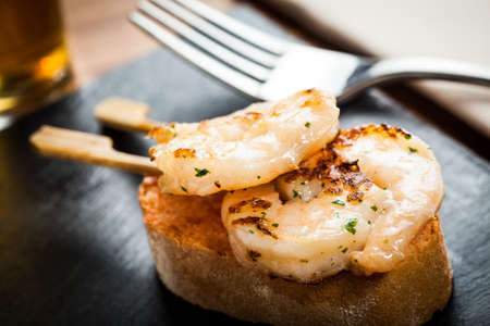 Prawn appetizer in a slice of bread, ready to eat