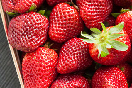 Bunch of fresh strawberries in a wooden box  High resolution