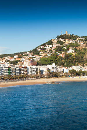 sa: View of the Blanes beach with the St. John Castles at the top of the mountain. Girona - Costa Brava.