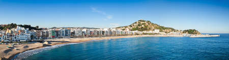 Panoramic view of Blanes, with St John Castle on top of the hill and the shoreline in high resolution.