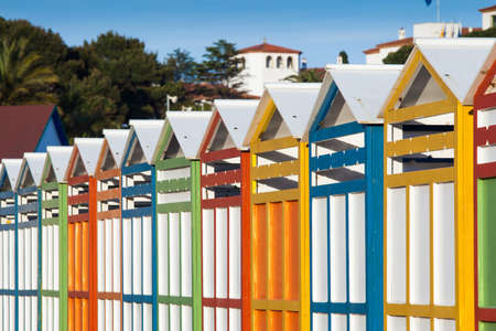 Row of summer beach cabins. photo