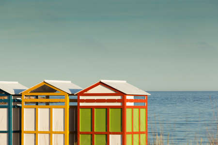 Row of summer beach cabins.
