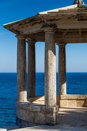 View of a mediterranean gazebo in Costa Brava, in Camí de Ronda a small pathway near the sea. Vertical format.