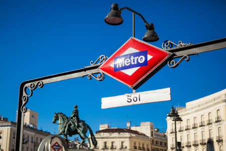 Sign of the Metro station of Puerta del Sol in the heart of Madrid with a great and clear blue sky.
