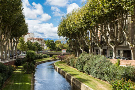 Picturesque view of Perpignan and its river in a sunny day. France.