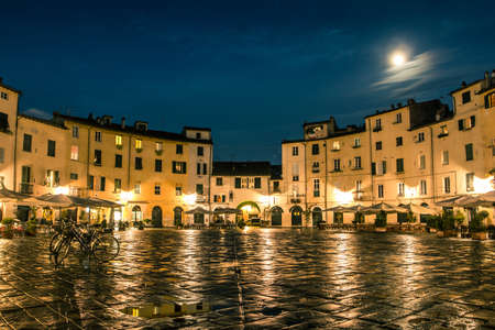 lucca: Amphitheater square in Lucca after rain. Tuscany, Italy.