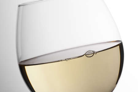 sauvignon blanc: Close up of white wine glass in a white degraded background. Cleaned with photoshop. Stock Photo