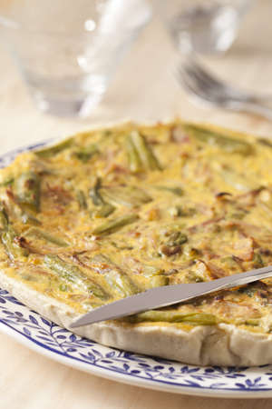 epicurean: Delicious aspargus homemade quiche on a dish. Stock Photo