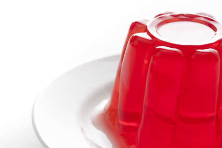 gelatin: Red gelatin on a dish.