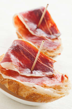Jabugo ham tapas. First quality of spanish ham. photo