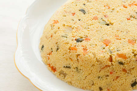 macrobiotic: Fresh couscous cake. Macrobiotic and healthy dish.