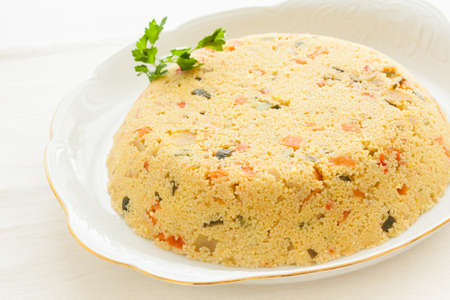 macrobiotic: Fresh couscous cake. Macrobiotic dish.