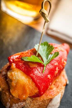 toothpick: Typical spanish stuffed pepper called pimientos del piquillo tapas.