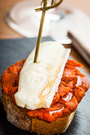 Spanish sobrasada with brie cheese tapas.