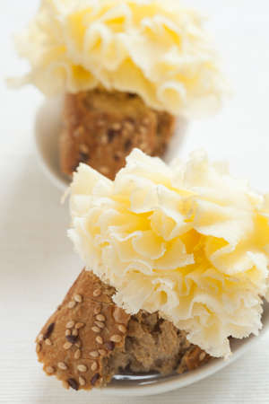 epicurean: Two snacks of Tete de Moine french cheese.