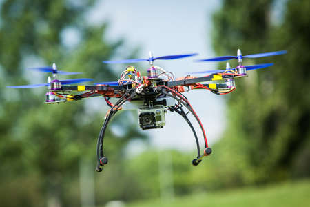 Flying a homemade helicopter with 6 rotors called hexacopter. Stock Photo