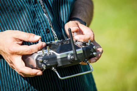 Controlling a remote helicopter drone. Archivio Fotografico