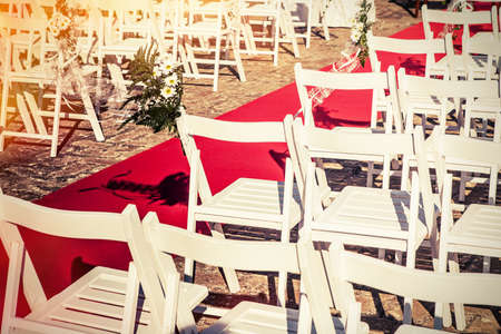 Outdoors wedding chairs in a sunny day. Stock Photo