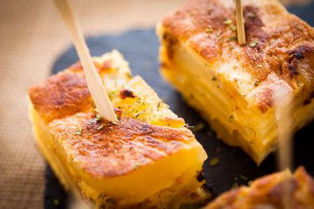 toothpick: Tortilla de patatas typical spanish pub food.