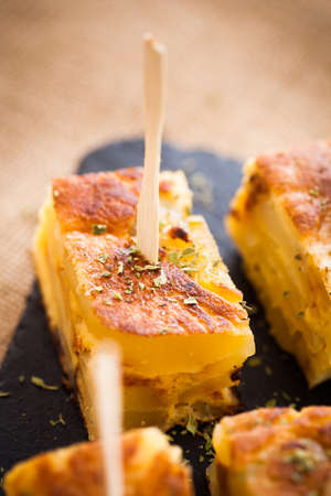 Spanish omelet tapas, typical spanish pub food. Stock Photo - 21296697