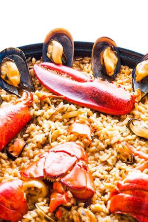 Traditional spanish paella isolated on white background. Stock Photo