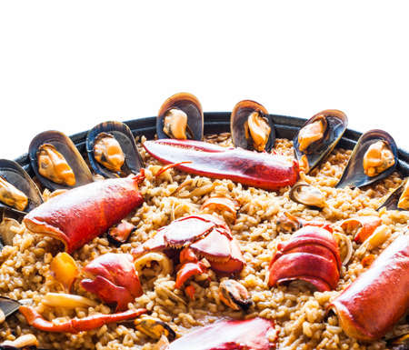 Traditional spanish paella isolated on white background  photo