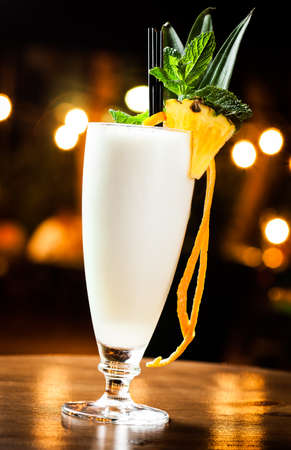 Great pina colada cocktail in a night pub  photo