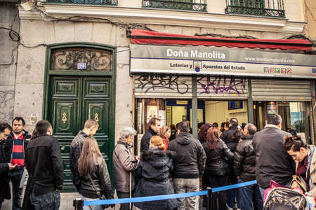 MADRID, SPAIN - 06 DECEMBER: People buys Christmas lottery tickets in Dona Manolita, the most famous lottery stall in the Country. Madrid december 06, 2011.