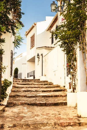 Street of Calella de Palafrugell, small traditional fishers village of Costa Brava. Stock Photo