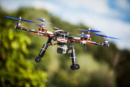 Professional carbon drone with GPS making a ride. Stock Photo