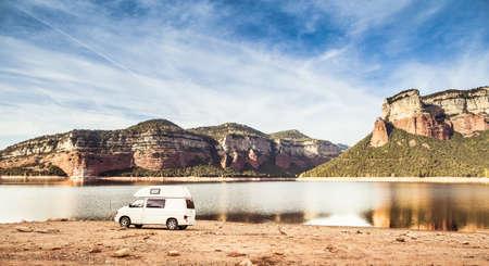 Motorhome camped in natural reservoir of Sau Lake. Osona.