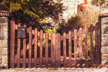 Old wooden entrance with vintage colors. photo