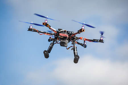 Professional carbon drone with GPS and video camera making a ride.