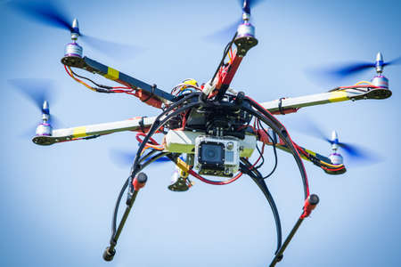 Remote drone flying with video camera on board. photo