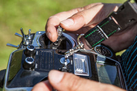 Hands in remote controller for drive a Drone. photo