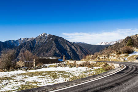 tourism in andorra: High mountain road in a sunny day. Stock Photo