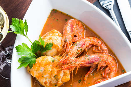 Cooked monkfish with fresh prawn, ready to eat. Stock Photo