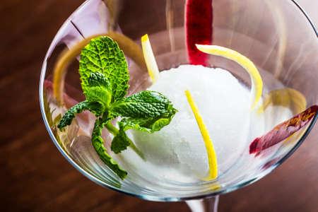Delicious lemon sorbet in a glass.