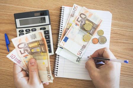 Detail of hands making financial balance.