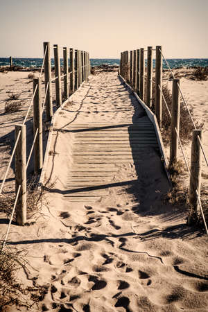 lonliness: Lonely beach pathway with vintage colors